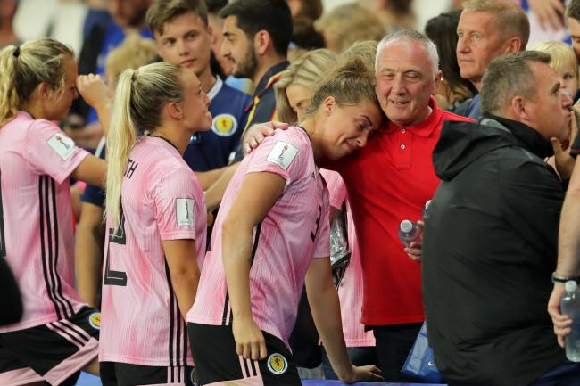 Scotland players are consoled after their heartbreaking draw against Argentina