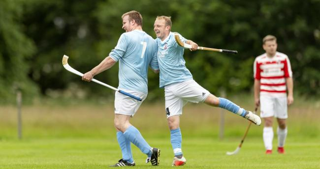 Caberfeidh's Ali MacLennan, left, celebrates with Kevin Bartlett after scoring in the Tulloch Homes Camanachd Cup. Photograph: Neil Paterson