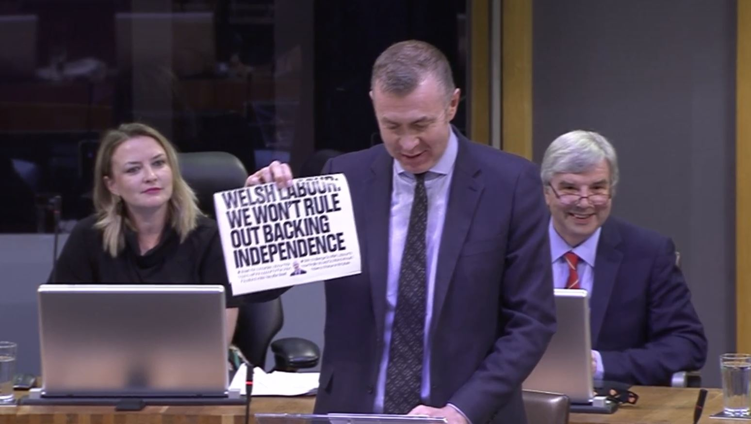 Plaid Cymru leader holds up National front page in Welsh FMQs