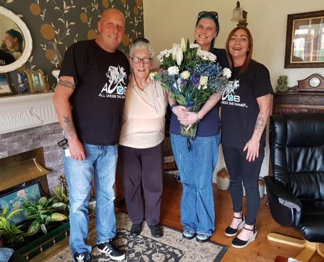 The AUOB team visited Isabel Wallace at her home to thank her