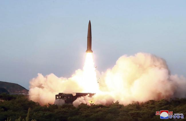 The North Korean government have released images showing a test missile launch
