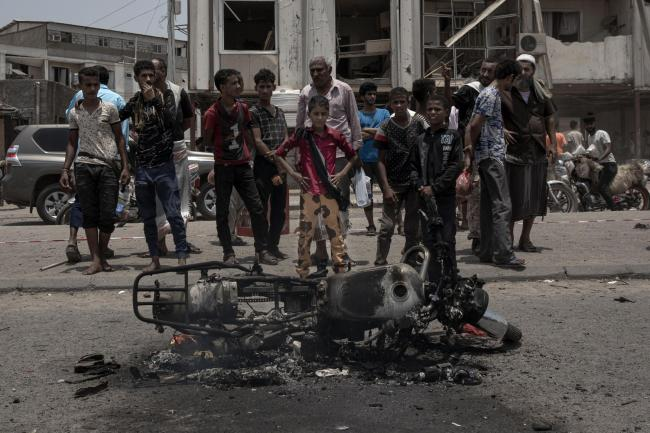 Civilians gather at the site of a deadly attack in Aden, Yemen