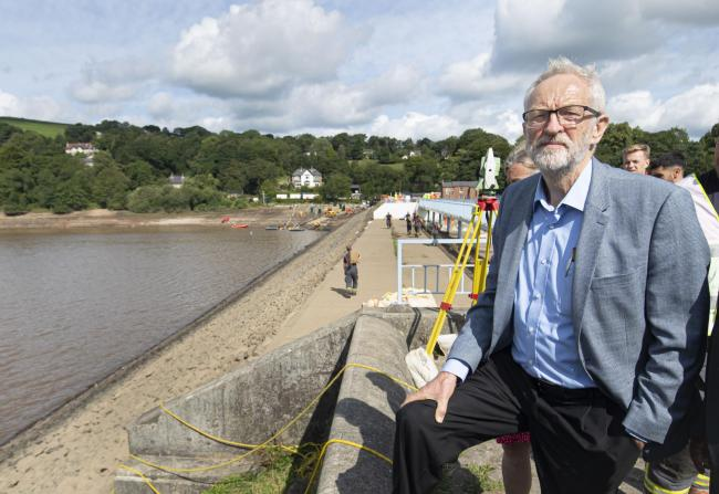 Labour Leader Jeremy Corbyn looks at the Toddbrook Reservoir that was damaged in heavy rainfall, during a visit to the village of Whaley Bridge in Derbyshire. PRESS ASSOCIATION Photo. Picture date: Monday August 5, 2019. See PA story WEATHER Rain. Photo c