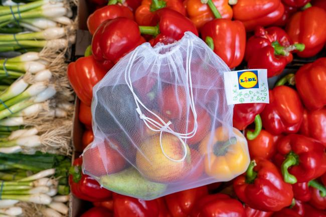 Discount chain Lidl will sell reusable fruit and vegetable bags in its stores as it aims to reduce plastic packaging by 20%