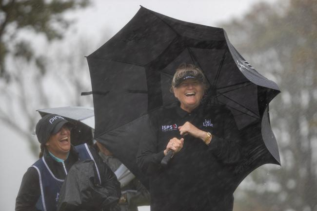 Laura Davies laughs off the appalling weather at the Ladies Scottish Open