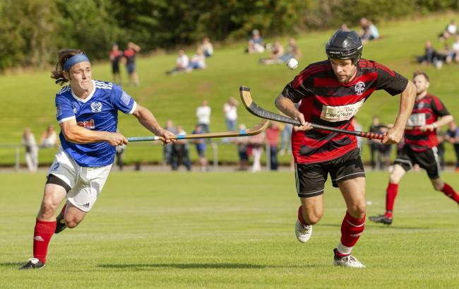Oban's Daniel Cameron, right, gets away from Kyles' Andrew King