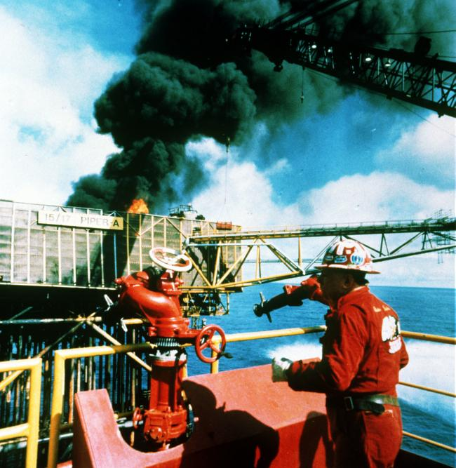 Legendary fire fighter Red Adair on board the still burning offshore platform Piper Alpha