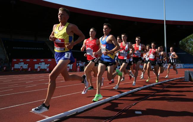 Andy Butchart leads the men's 5000m during the British Athletics Championships