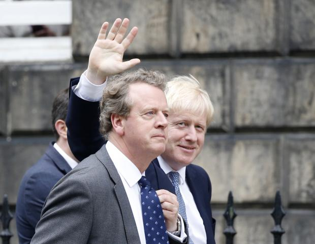 The National: Boris Johnson waves at the press with Alister 'Absent' Jack