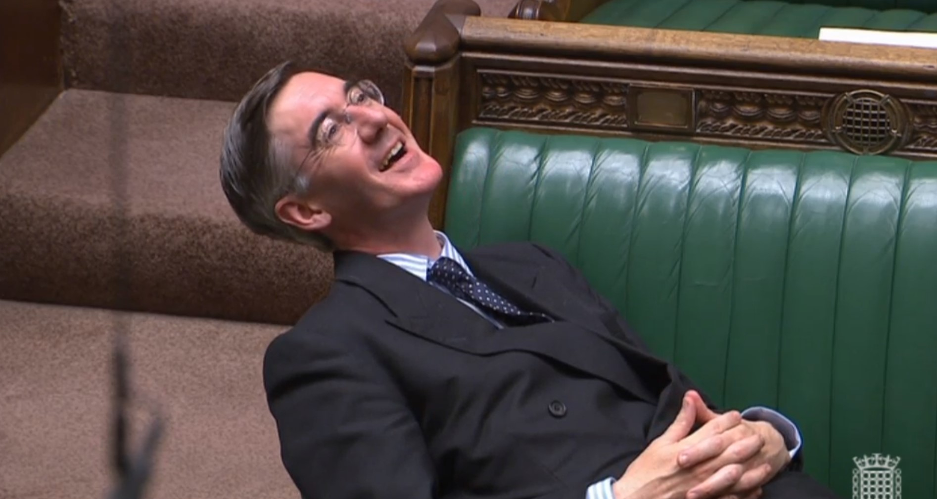 Jacob Rees-Mogg lounges on Commons benches during Brexit debate