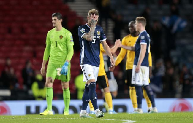 Scotland centre half Liam Cooper holds his head after the Belgium game. Picture: Graham Stuart/PA Wire.