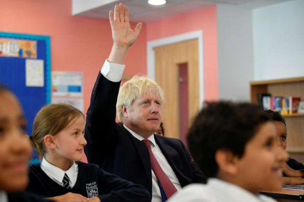 The National: Boris Johnson attends a history lesson at Pimlico Primary School in south-west London