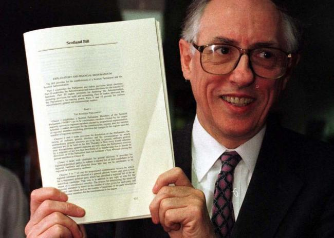 Donald Dewar, Scotland's first first minister, with the Bill creating Scotland's parliament