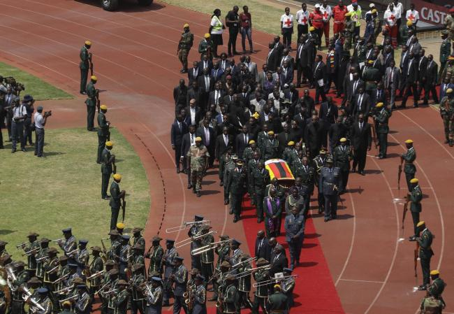Former Zimbabwean President Robert Mugabe's coffin arrives for a state funeral for at the National Sports Stadium in Harare