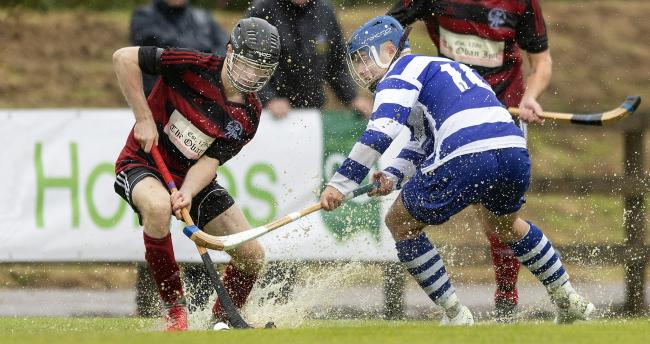 Oban's Daniel Sloss, left, and Iain Robinson of Newtonmore during the Camanachd Cup final before it was abandoned