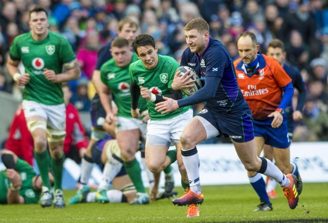 Finn Russell in action for Scotland against Ireland during the Six Nations