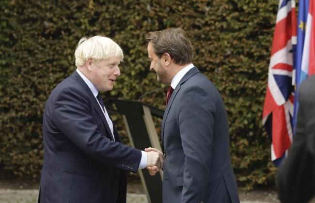 A clearly furious Xavier Bettell, the prime minister of Luxembourg, went ahead with the Q&A without Boris Johnson after the pair met for talks
