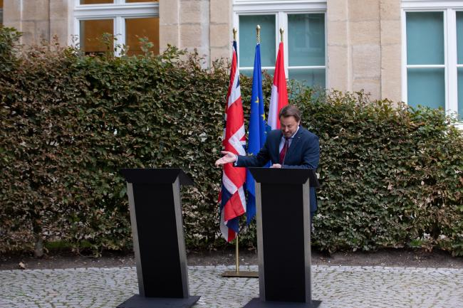 Luxembourg Prime Minister Xavier Bettel gives the press conference alone after Boris Johnson failed to show