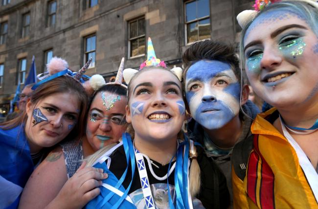 Young pro-independence demonstrators take part in a march through Edinburgh, during the All Under One Banner march