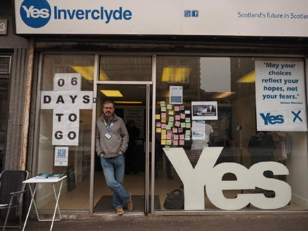 The National: Ronnie Cowan outside of the Inverclyde Yes shop in 2014