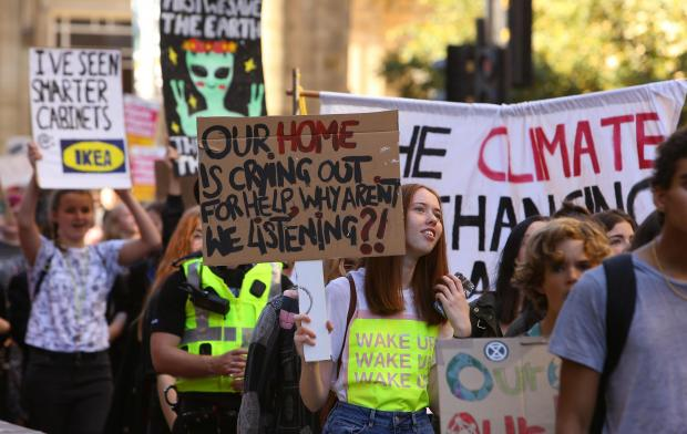 The National: Climate strikers took to the streets of Glasgow