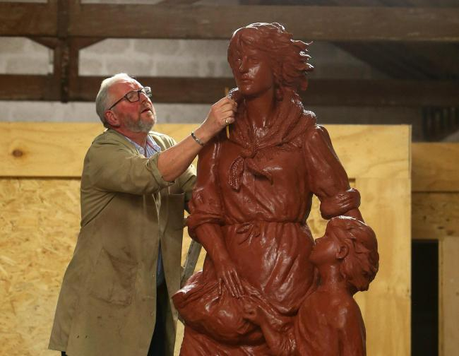 Artist Alan Herriot works on the clay version of the Pittenweem Fishermen's Memorial