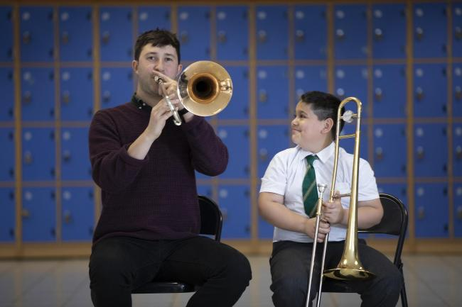 Andrei Lazar, 10, from Big Noise Govanhill with Jonny Hollick of the BBC Scottish Symphony Orchestra