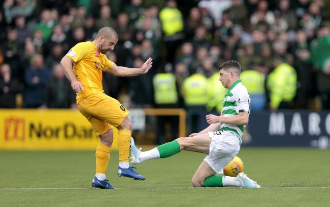 Celtic attacker Ryan Christie saw red for this lunge on Livingston's Scott Robinson.
