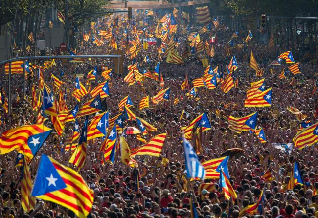 Pro-independence demonstrators march in Barcelona on Diada de Catalunya, the National Day of Catalonia
