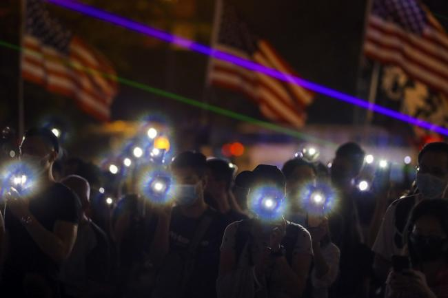 Protesters flash their smartphone's lights to give support the prayer rally at Edinburgh Place in Hong Kong