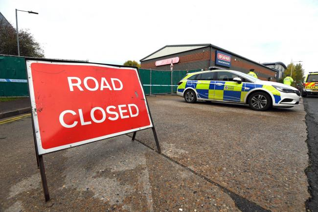 Police at the industrial estate in Grays, Essex, where 39 bodies were discovered in a lorry