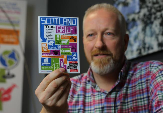 Business for Scotland chief Gordon MacIntyre-Kemp unpacks Scotland the Brief, a new myth-busting booklet being distributed to Yes groups across the country. Photograph: Colin Mearns