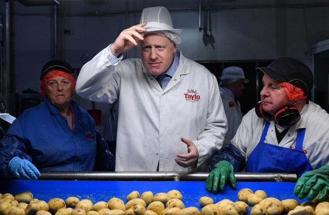 Boris Johnson visited Tayto crisp factory in Armagh as part of his General Election campaign yesterday
