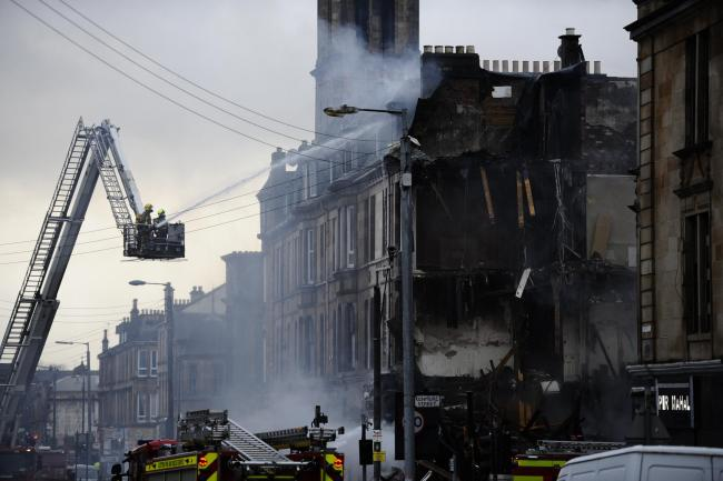The fire at the Strawberry and Spice Garden grocery store in Albert Drive, Glasgow, led to the collapse of a tenement