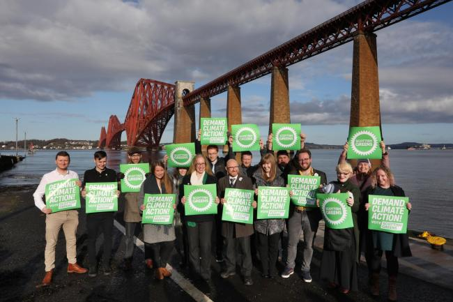 Scottish Green's co-leaders Patrick Harvie and Lorna Slater and candidates with the background of the Forth Rail Bridge