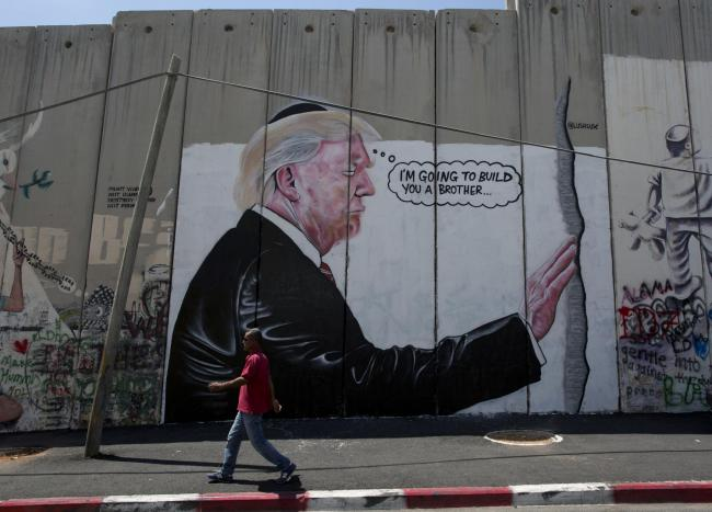 Banksy's mural of Donald Trump on the West Bank separation barrier back in 2017
