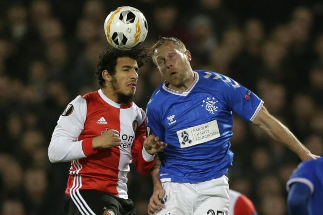 Rangers midfielder Scott Arfield, right, challenges Yassin Ayoub of Feyenoord, left, for the ball in Rotterdam on Thursday night. Picture: AP Photo/Peter Dejong.