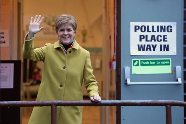 The National: Nicola Sturgeon arrives to cast her vote