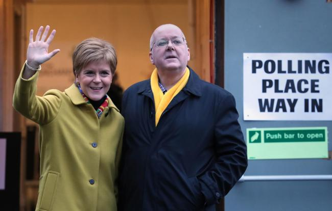 Peter Murrell with his wife Nicola Sturgeon after casting their votes in the 2019 General Election Photo PA