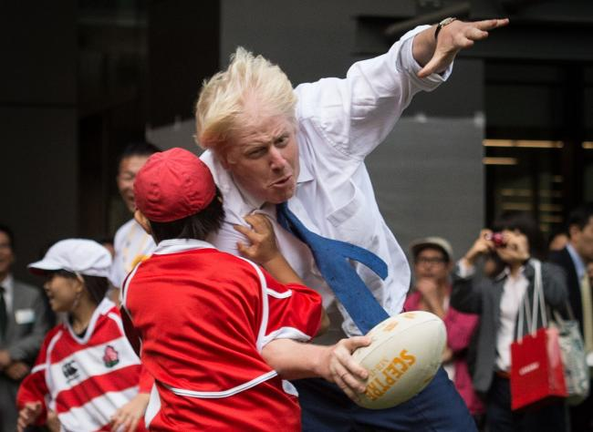 Boris Johnson knocks over an eight-year-old as he bids to impress