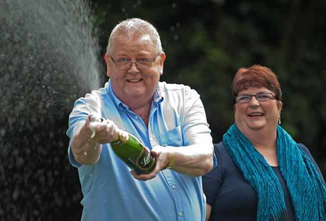 Colin Weir, pictured with then-wife Chris, won £161 million in the summer of 2011