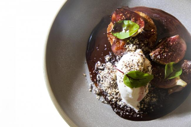 Poached figs, hazelnut cake and dark chocolate sauce. Picture: Gerardo Jaconelli