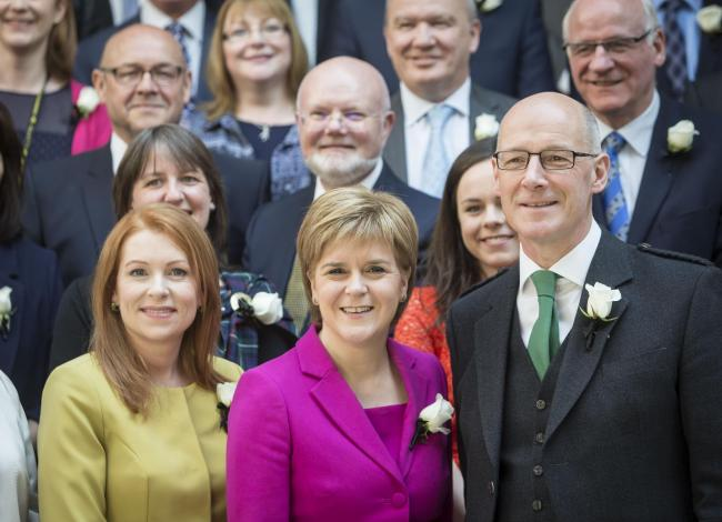 Nicola Sturgeon and John Swinney pose with the SNP group elected in 2016
