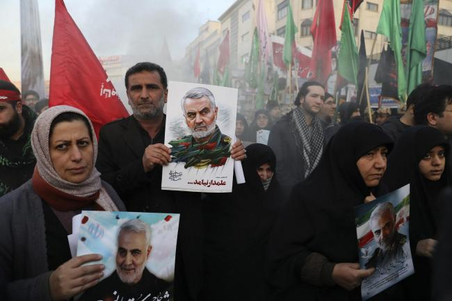 Mourners attend a funeral ceremony for Iran's top general Qasem Soleimani, who was killed by the United States
