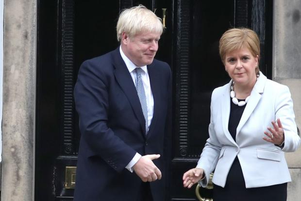 The National: Boris Johnson and Nicola Sturgeon