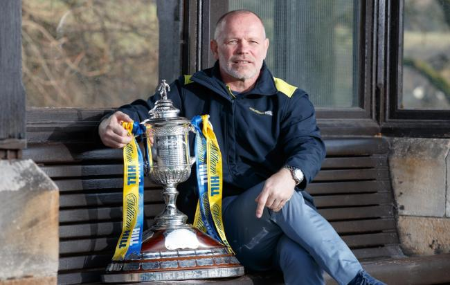 John Hughes believes the title race between Celtic and Rangers is good for the Scottish game.