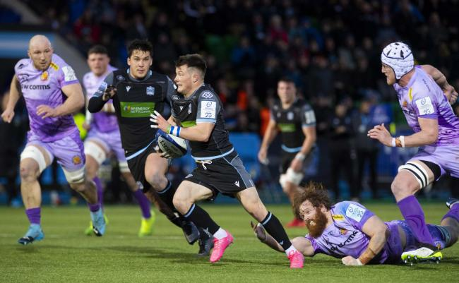 Glasgow Warriors' George Horne drives through for a try against Exeter