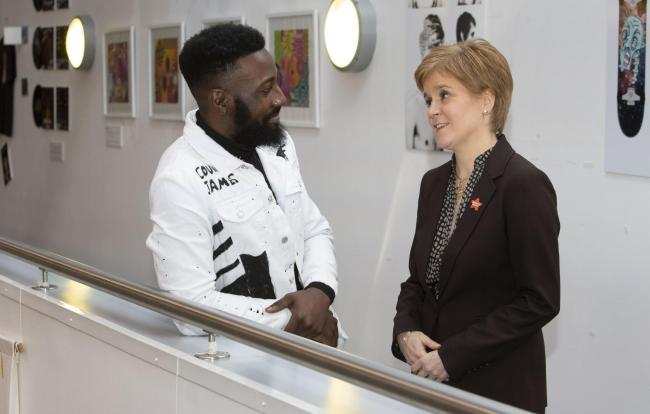 Accountancy student Courage Eregbu meets the First Minister to discuss a new initiative.