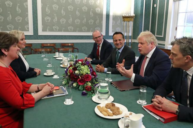 From left: Arlene Foster of the DUP, deputy first minister Michelle O'Neill, Ireland's deputy premier Simon Coveney, Taoiseach Leo Varadkar, Prime Minister Boris Johnson and Secretary of State for Northern Ireland Julian Smith
