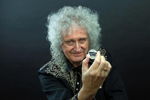 The National: Queen guitarist Brian May with the Queen 2020 UK £5 brilliant uncirculated coin